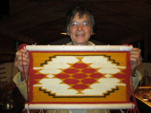 Sampler with butterfly pattern