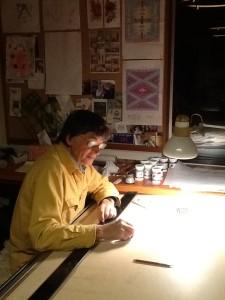 John designing his next weaving.